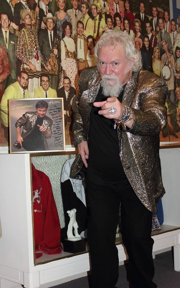 country legend t graham brown trying on his old stage suit at the museum