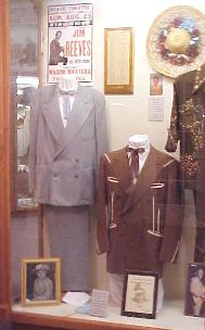 f our display honoring jim reeves contains two of his suits a record award and a grammy nomination plaque
