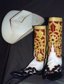 g custom made black white yellow and red boots and a white cowboy hat from country music hall of famer carl smith