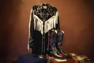 h hank williams jur nudie designed musical shirt aling with his custom made monogaammed boots 1