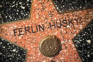 j ferlin huskys extensive display includes his tailored tux first guitar0rhinestone guitar strap and hollywood walk of fame award 1975 cadillac limo 2