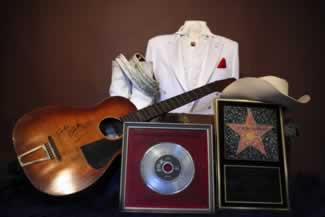 j ferlin huskys extensive display includes his tailored tux first guitar0rhinestone guitar strap and hollywood walk of fame award 1975 cadillac limo 5