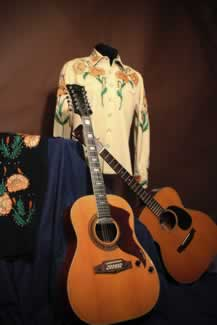 s the tall texan billy walkers 1965 martin and 12 string vox guitars with his manuel stage suit and pants 1